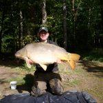 Carp fishing in France - man holding 30lb carp